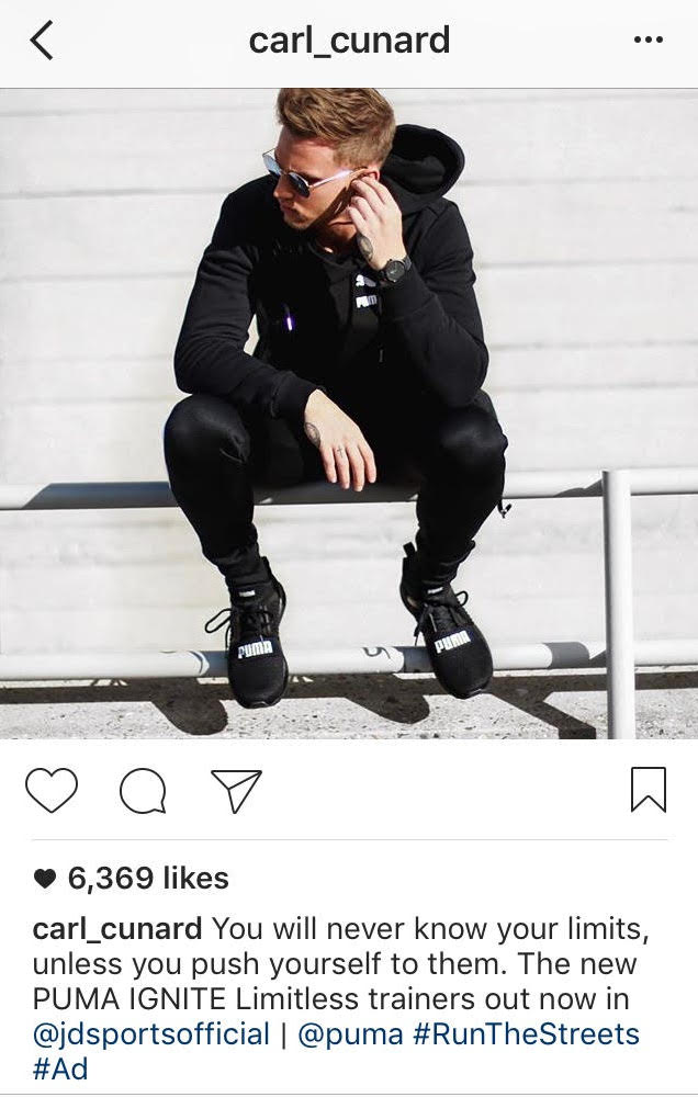Instagram post of man in black clothes and trainers