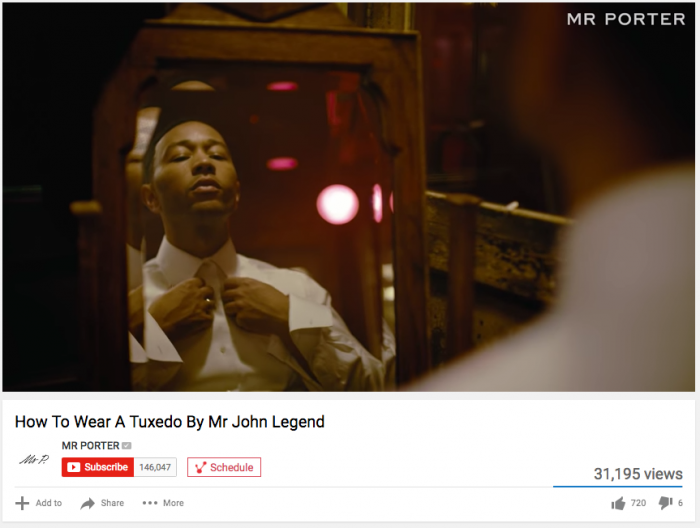 Video still of John Legend in a white shirt