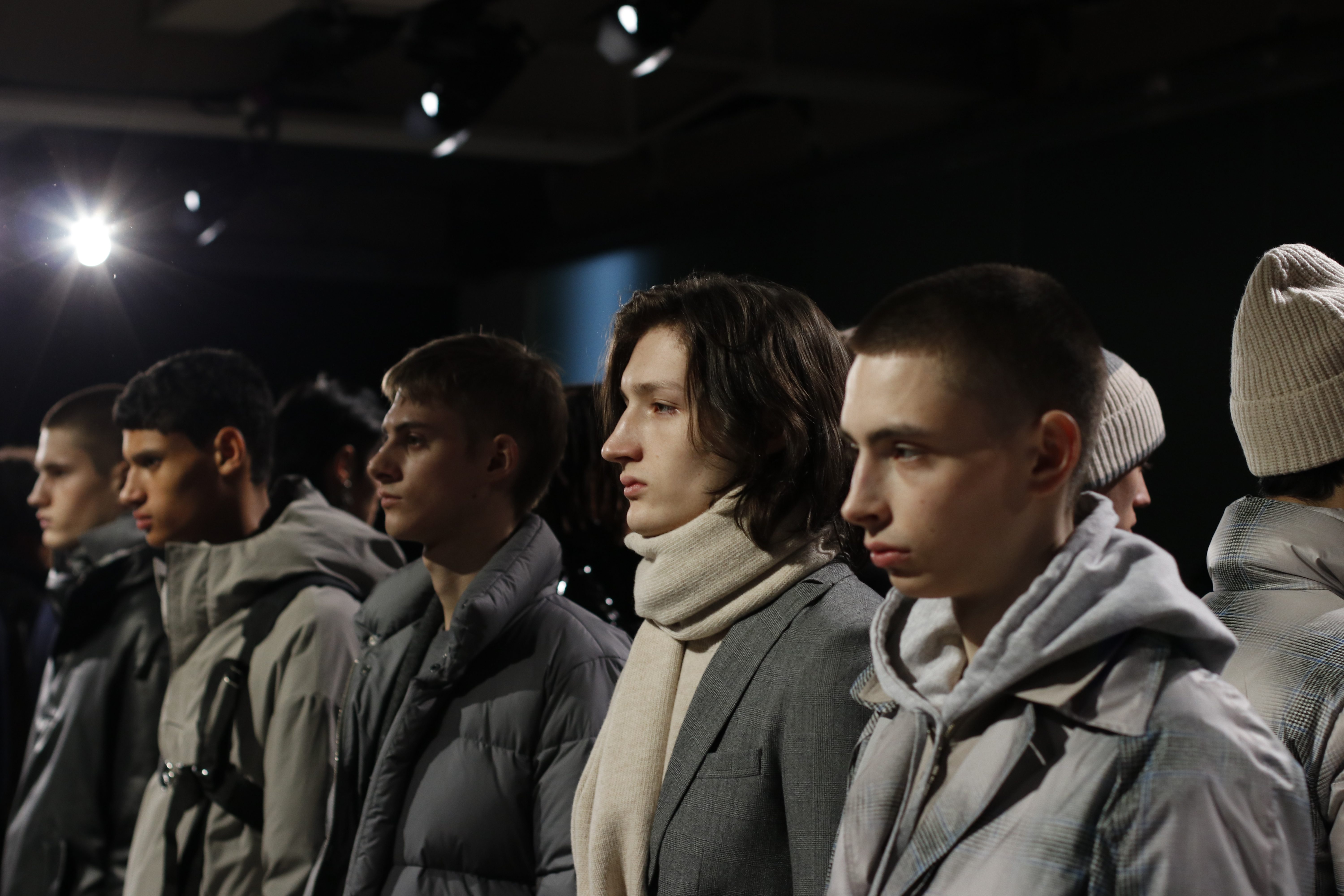 male models lined up on catwalk